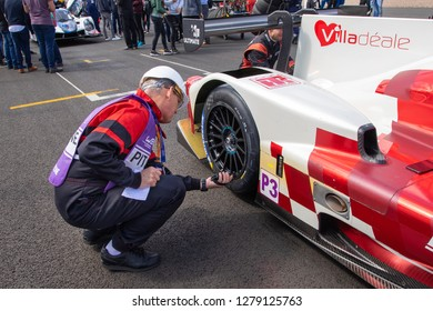 Silverstone Circuit, Northamptonshire, England, August 18 2018. Scrutineer checks tyres on the start grid of the ELMS 4 Hours of Silverstone 2018.