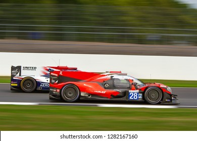 Silverstone Circuit, Northamptonshire, England, August 18 2018. IDEC Sport Oreca 07 - Gibson LMP2 challenging United Autosports LMP2 between Copse and Maggotts, ELMS 4 Hours of Silverstone 2018.
