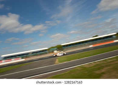Silverstone Circuit, Northamptonshire, England, August 18 2018. RLR Sport Ligier JS P3 - Nissan LMP3 in a race track landscape with large blue sky and clouds, ELMS 4 Hours of Silverstone 2018.