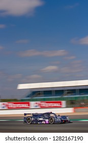 Silverstone Circuit, Northamptonshire, England, August 18 2018. Eurointernational Ligier JS P3 - Nissan LMP3 at bottom of image with large blue sky and clouds, ELMS 4 Hours of Silverstone 2018.
