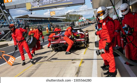 Silverstone Circuit, UK, Aug 29 - Sept 1 2019. MR Racing pit crew get ready for a pit stop with Red River Racing Ferrari pit stop in background. WEC 4 Hours of Silverstone