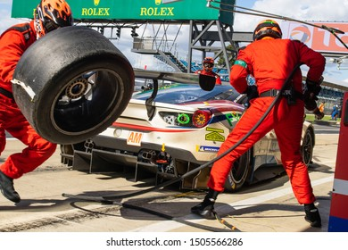 Silverstone Circuit, UK, Aug 29 - Sept 1 2019. Mechanic runs with wheel during pit stop for MR Racing Ferrari 488. WEC 4 Hours of Silverstone