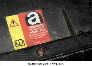 Silverstone, Northamptonshire/ United Kingdom - April 30 2020 - a notice under the bonnet of a 1988 Land Rover warning of the presence of asbestos, a carcinogen, in the engine bay