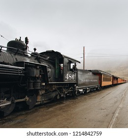 SILVERTON, CO, USA - OCTOBER 7, 2018: Durango to Silverton steam rail, steam engine waiting in cloudy Silverton before return trip to Durango.