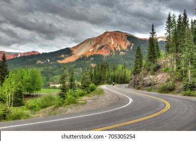 Silverton, Colorado - a motorcyclist travels along the Million Dollar Highway in southwest Colorado through the La Plata Mountains (Rocky Mountains)