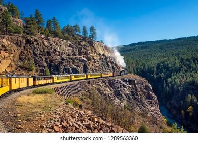 Silverton, Colorado, USA - October 15, 2018 : Tourists ride the historic steam engine train from Durango to Silverton through the San Juan Mountains in Colorado, USA.