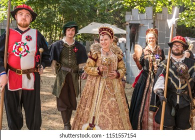 Silverton, Oregon - August 4, 2018: The Queen and her court followers at the Renaissance Fair.