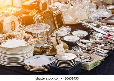 Silverware and dishes on a afternoon Parisian flea market