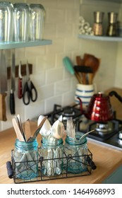 Silverware in a utensil rack on a kitchen counter in a modern lifestyle scene with space for text on top
