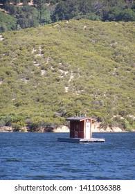 Silverwood Lake, California:  Floating outhouse on lake