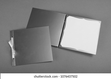 Silvery greeting cards on a gray background. To be used for invitations
