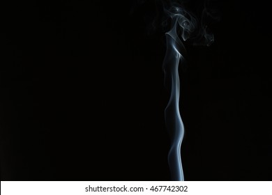 Silvery spear of smoke rising on black