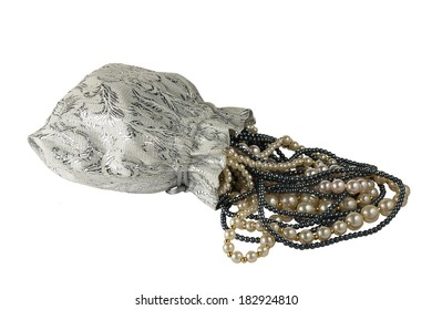 Silvery white bag with the hanging by threads of white and black pearls. Isolated on white background.