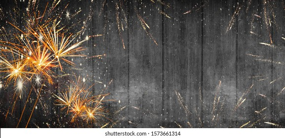 Silvester background banner firework 2020 new year party on black rustic wooden texture with space for text