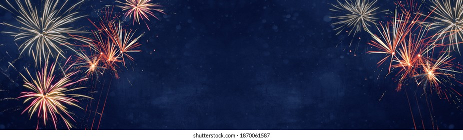 Silvester background banner panorama long- Colorful firework on rustic dark blue night sky texture