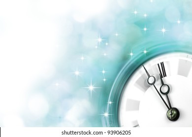 Silvester clock- blue version - light blue blurry background with vintage clock nearly before midnight