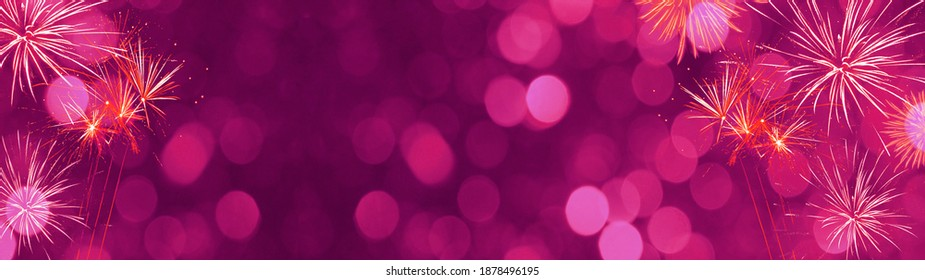 Silvester Party Festival New Year background banner panorama long greeting card template - Festive pink firework and bokeh lights isolated on dark magenta night sky, with space for text