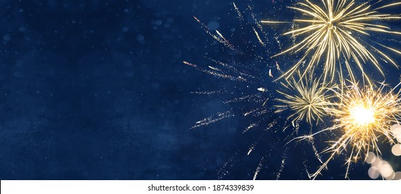 Silvester party New year background banner panorama long- sparklers and bokeh lights on dark blue night sky texture, with space for text