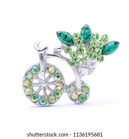 silwer brooch bicycle with gems and flowers isolated on white