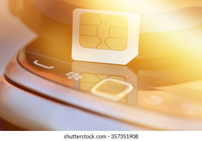 Sim card on cell phone background