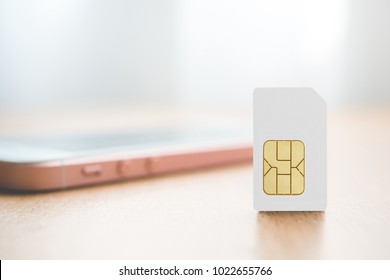 Sim card put on wood table. Technology concept.