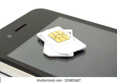 sim card and smart phone on white background