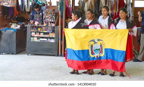 SIMBAMBE, ECUADOR - APRIL 12, 2019: Dancers with an Ecuadorian flag at the train station