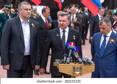 Simferopol, Red, Crimea - May 8, 2015: The opening of memorial to victims of fascism on site of the concentration camp of death. Leaders of Crimea Sergei Aksyonov and Vladimir Konstantinov.