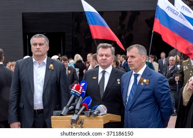 Simferopol, Red, Crimea - May 8, 2015: The opening of the memorial to the victims of fascism on the site of concentration camp of death. Leaders of Crimea Sergei Aksyonov and Vladimir Konstantinov.