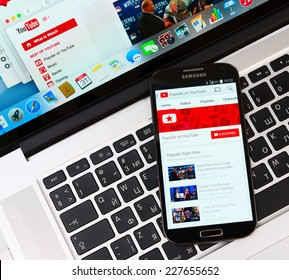 SIMFEROPOL, RUSSIA - NOVEMBER 01, 2014:  Youtube application on Samsung Galaxy S4 over Apple Macbook Pro keyboard. YouTube is the popular online video-sharing website, founded in February 14, 2005