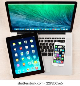 SIMFEROPOL, RUSSIA - NOVEMBER 04, 2014: Apple iPhone 6, iPad and Macbook pro over table. Apple Inc. is an American multinational corporation that designs, develops, and sells consumer electronics.