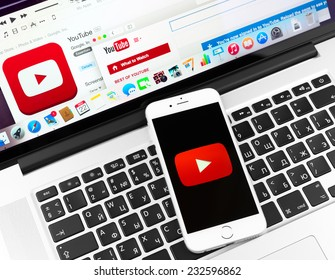 SIMFEROPOL, RUSSIA - NOVEMBER 22, 2014:  Youtube icon on Apple iPhone 6 and Macbook display. YouTube is the popular online video-sharing website, founded in February 14, 2005
