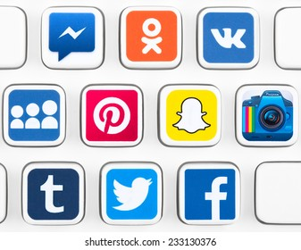 SIMFEROPOL, RUSSIA - NOVEMBER 25, 2014: Popular logotypes of social networking applications printed on sticker and placed on a buttons of keyboard. Incl.: facebook, instagram, twitter and other