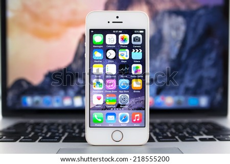 Simferopol, Russia - September 19, 2014: Apple iPhone 5S displaying iOS 8 homescreen. iOS 8 mobile operating system designed by Apple Inc. is an upcoming September 17, 2014.