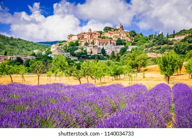 Simiane-la-Rotonde, hilltop village in Provence with lavender fields, France.