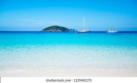 Similan island and vibrant turquoise blue Andaman sea. Phang Nga - Phuket, Thailand