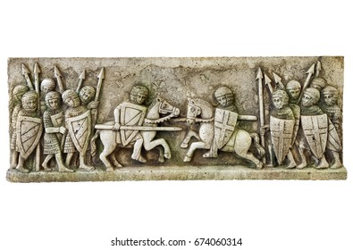 Simile of a classic medieval frieze showing a knights battle isolated on white background. Aged moss effect. Clipping path.