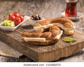 Simit, tea, feta cheese, olives, tomatoes