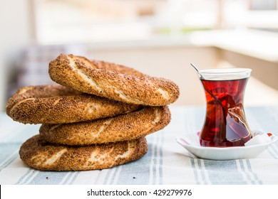 simit and tea on a blue tablecloth in the  balcony at home front view