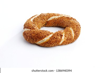 Simit, Turkish bagel covered with sesame seeds, isolated on white, side view
