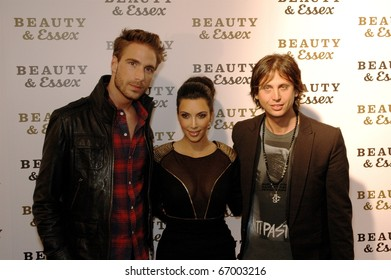 Simon Huck, Kim Kardashian & Jonathan Cheban attends Beauty & Essex Red Carpet in downtown Manhattan,NY on December 10, 2010.