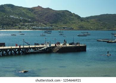 SIMON'S TOWN, SOUTH AFRICA - CIRCA SEPTEMBER 2018: Municipal pier in False Bay