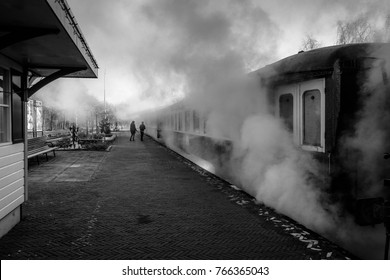 SIMPELVELD, NETHERLANDS – DECEMBER 31, 2016: An old steam locomotive standing at the Simpelveld train station waiting for the passengers to enter the train.