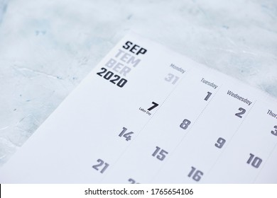Simple 2020 September monthly calendar on table with office supplies