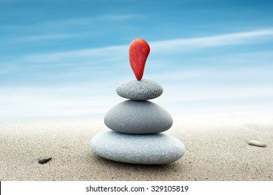 Simple abstract background of red and grey stones arranged in pyramid stack