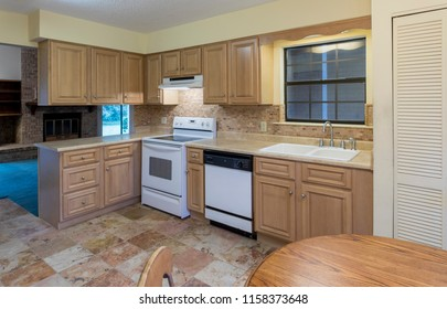 Simple American kitchen in need of remodel.