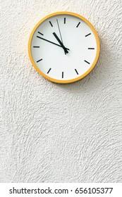 Simple analog clock on white wall loft concrete wall
