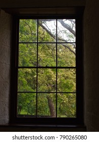 Simple Austere Window with a Radiant View of Lush Verdant Greenery.