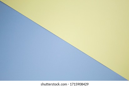 A simple background that is divided into two equal parts diagonally from left to right. Half of the background is light blue, the other half is light yellow. Concise business style. Field for text.