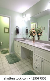 simple bathroom with double sinks and separate toilet